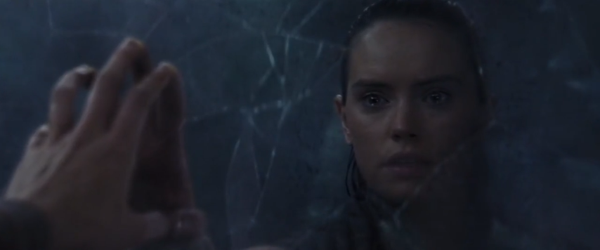 Rey is in the Ahch-To Pit looking at a broken mirror.